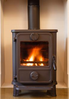When using woodstoves, logs often need to be stacked without the use of an  andiron.