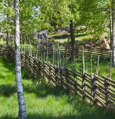 Wood rail fences often are used on large properties.