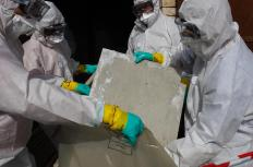 Asbestos contractors wear special suits to protect themselves from disturbed fibers.