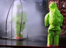 Workers involved with chemical decontaminations wear specialized suits to protect them from hazardous materials.