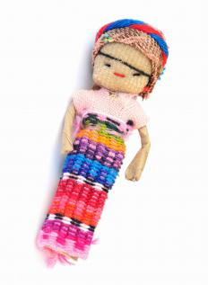 A worry doll with colorful skirt.