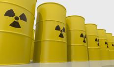 Dry cask nuclear waste storage uses durable barrels to hold toxic waste.