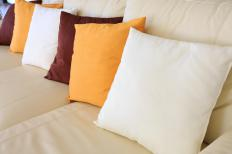 The colors of couch pillows should compliment the furniture.