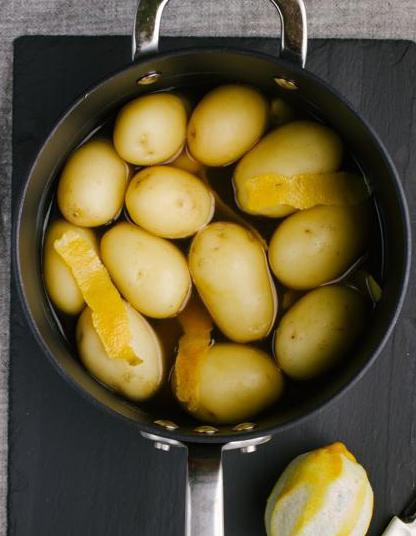 Boil potatoes until they are soft.