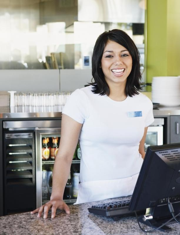 At a small cafe, the hostess may not only greet and seat customers but also operate the cash register.