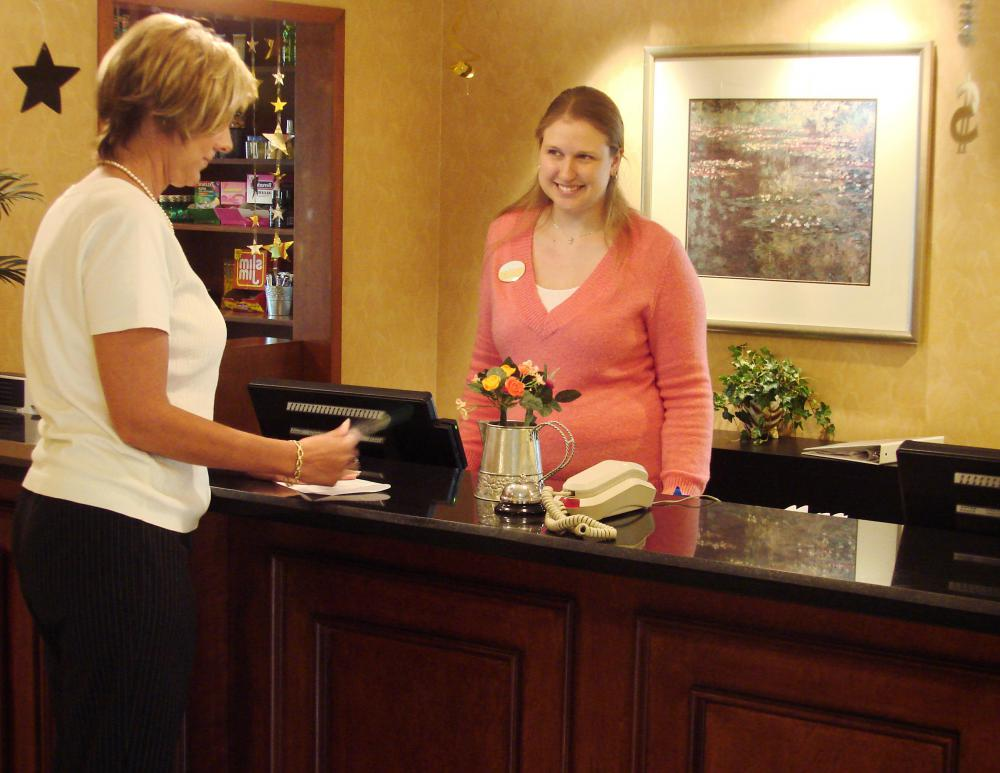 In a hotel describes the concierge and desk workers who make reservations and accept payments.
