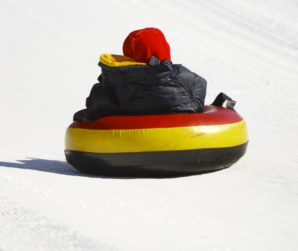 Snow tubing uses an inner tube to go down a snow covered hill.