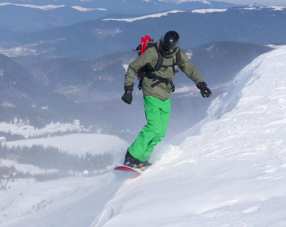 A snowboarder should quickly get rid of his board during an avalanche.