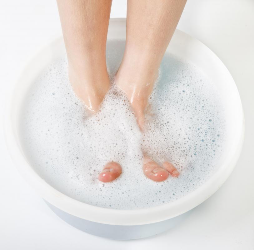 A person having a foot soak at a city spa.