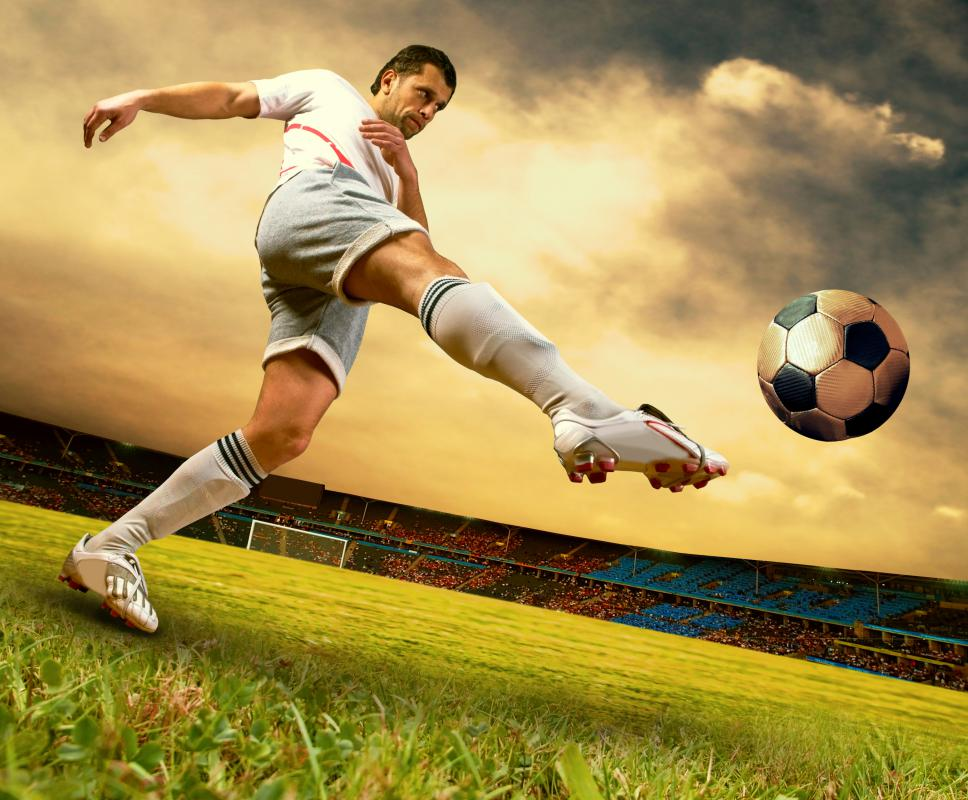 A soccer player kicking the ball.