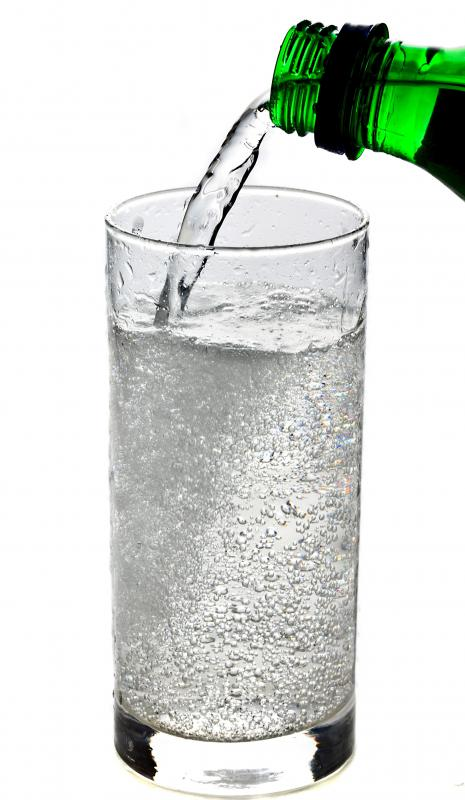 Soda being poured into a glass.
