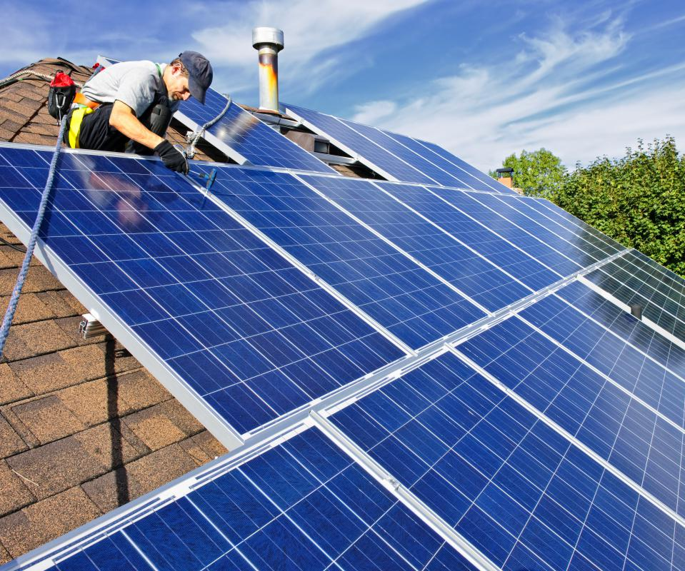 Solar energy companies install solar panels on homes and other buildings to harness the energy of the sun.