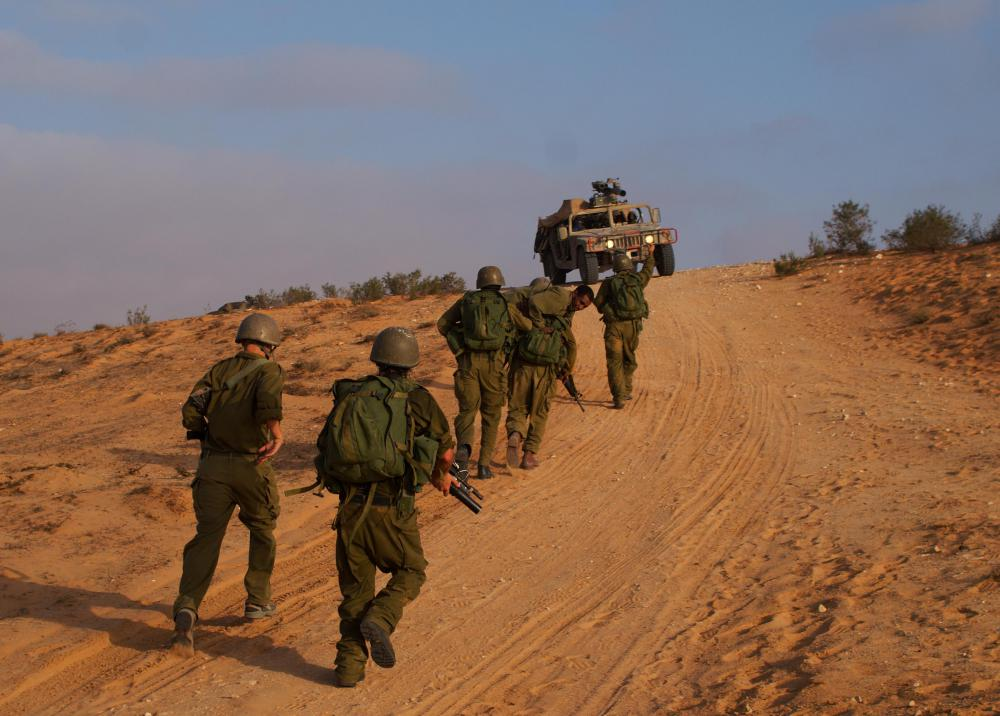 Soldiers may patrol borders by foot and ground vehicles.