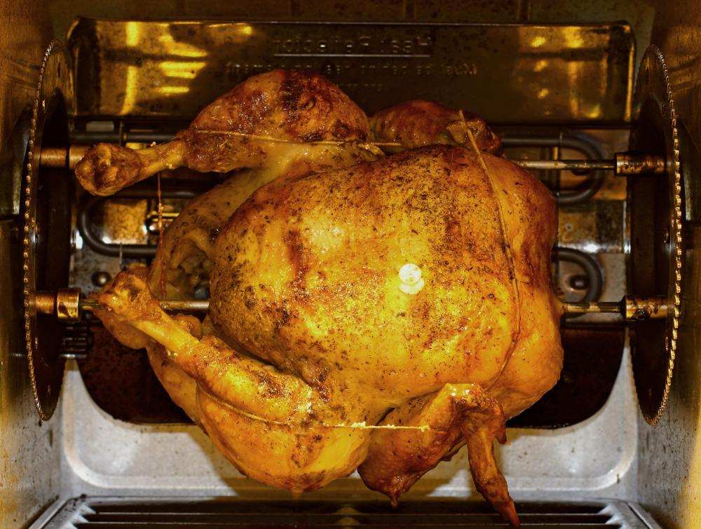 An electric rotisserie uses electricity to generate cooking heat.