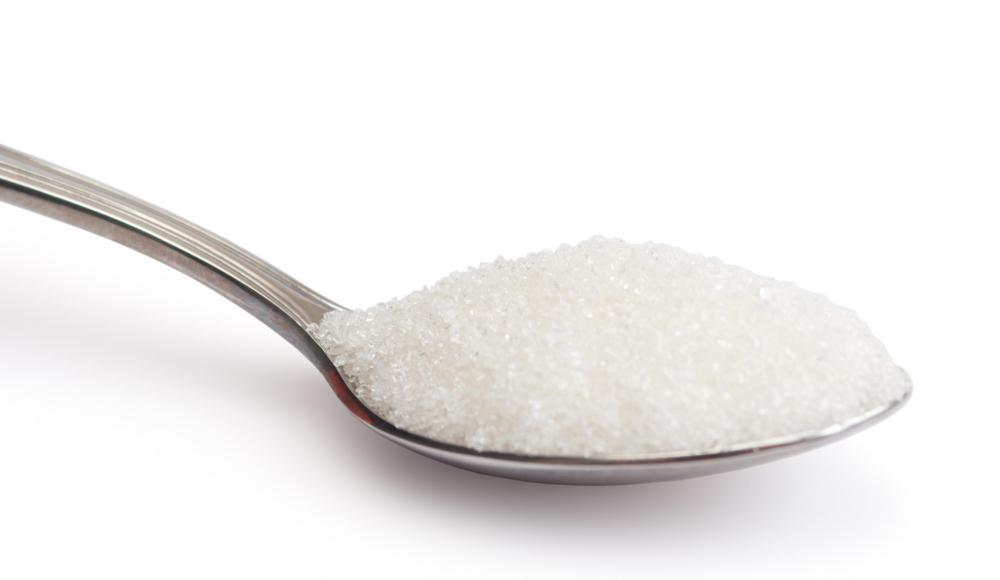A spoon of isomalt, a sugar substitute made from beet sugar.