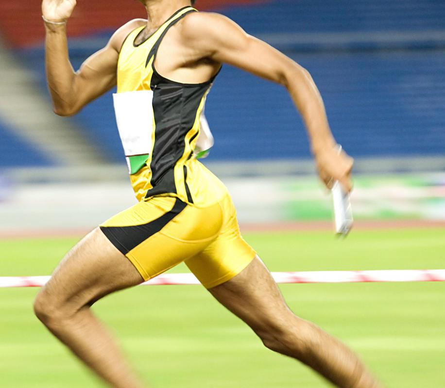 Runners in track events must react immediately at the start of a race.