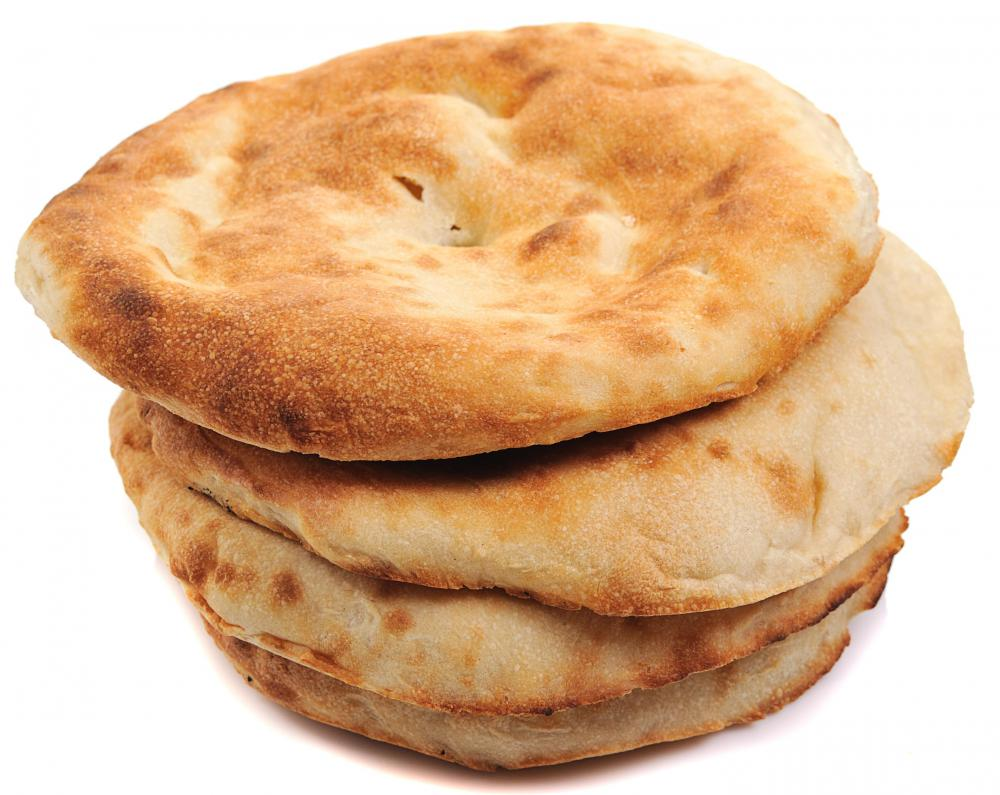 A stack of fresh pita bread.