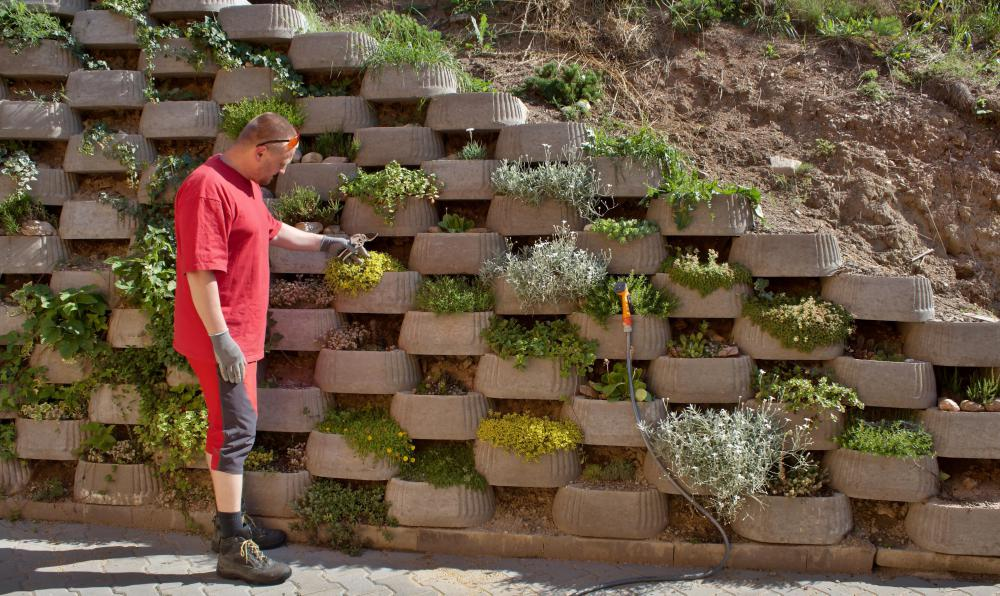 Although difficult to build, a retaining wall can be made in various attractive designs.