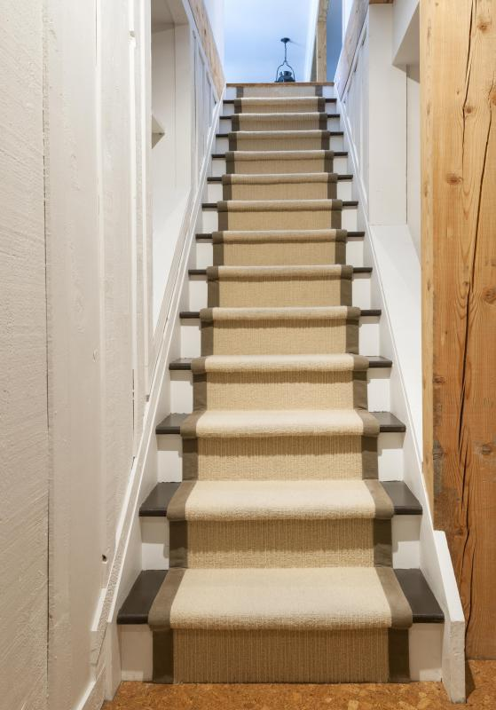 Skirting boards can be used to hide gaps between the staircase and the wall.