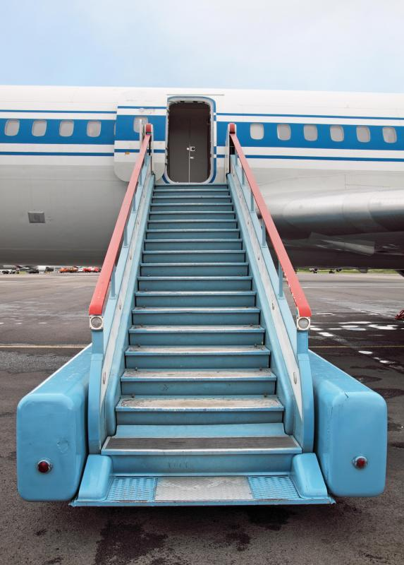 Stairs leading up to an airplane door. & Can You Open an Airplane Door During Flight? (with pictures) Pezcame.Com