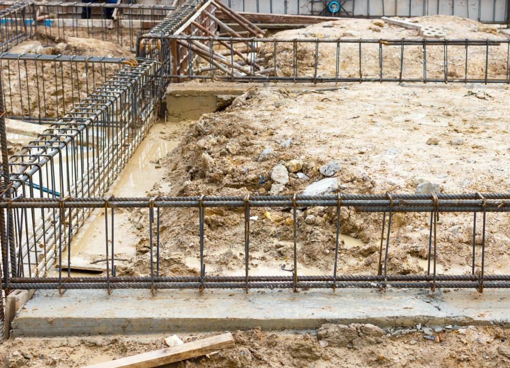 Metal reinforcing beams, or rebar, are placed in insulated formwork to provide stability.