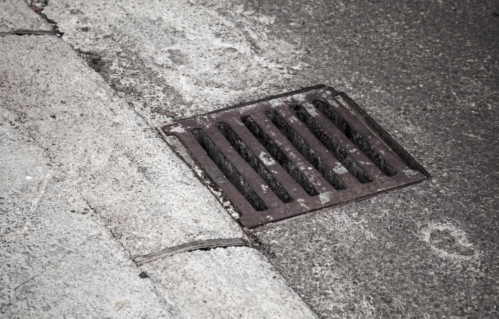 Storm drains collect large amounts of oil, grease, and coolant waste from parking lots and pass them on to the environment.
