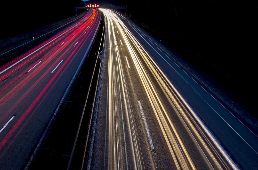 Filmmakers use remote time-lapse cameras to record actions over a period of time, such as car lights on a highway.