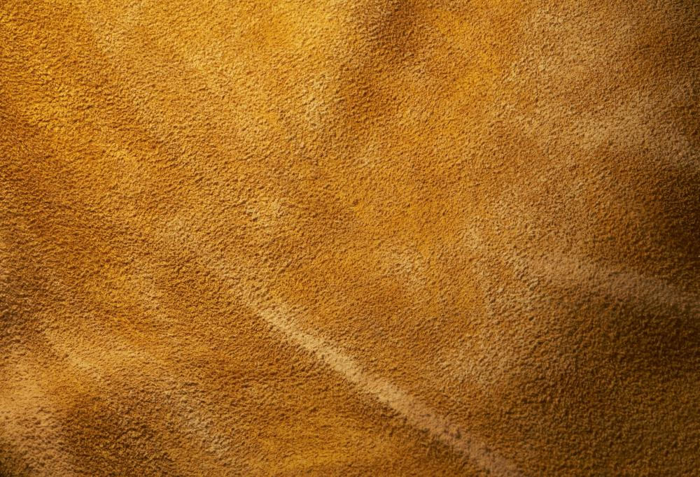 Suede is a type of leather that has a smooth, velvet-like surface.
