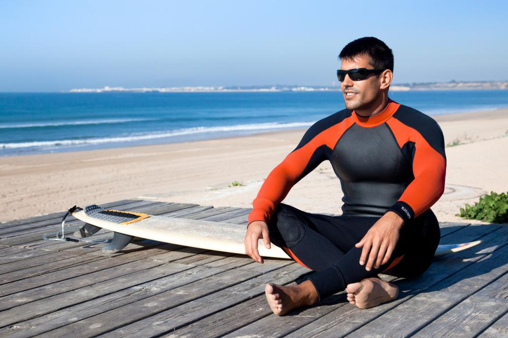 Surfers often wear full body wetsuit.