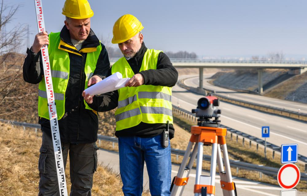 During new construction, building companies hire a residential land surveyor to mark out the boundaries between the plots of land on which new houses are to be built.