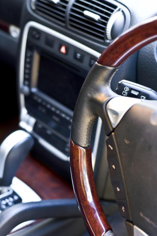 Prospective buyers at an auction will likely inspect a vehicle's interior, among other elements.