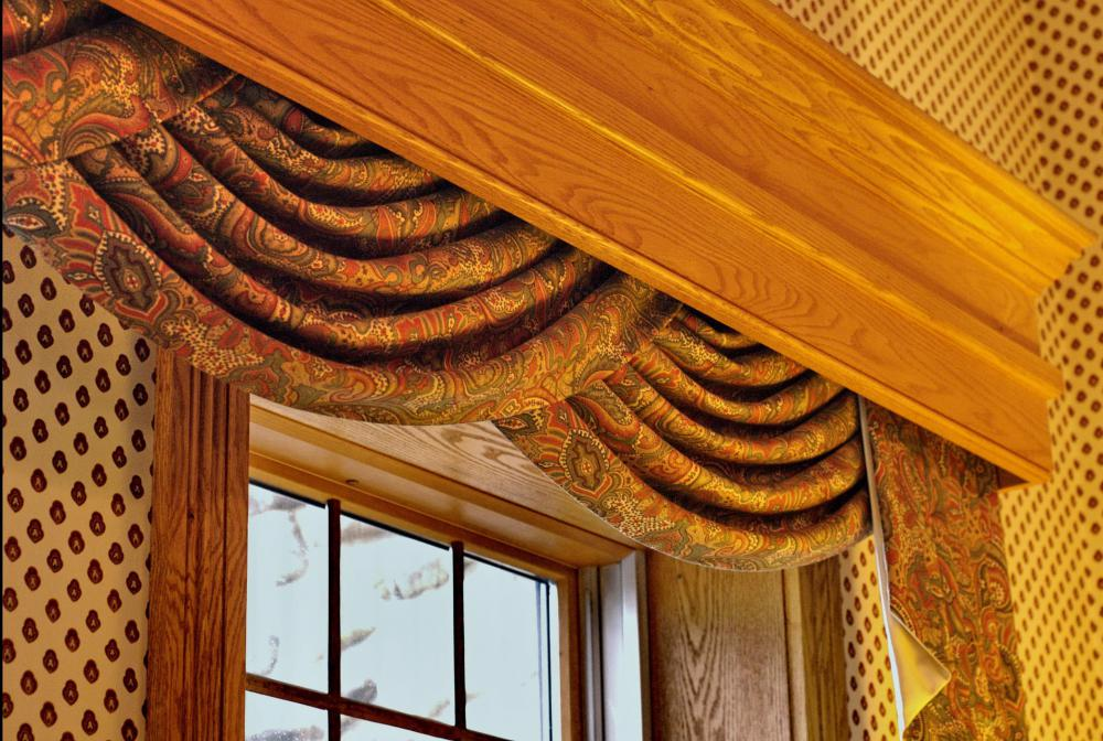 Typically larger than the top frame of a window, a valance can cover rods, brackets and other curtain hardware.