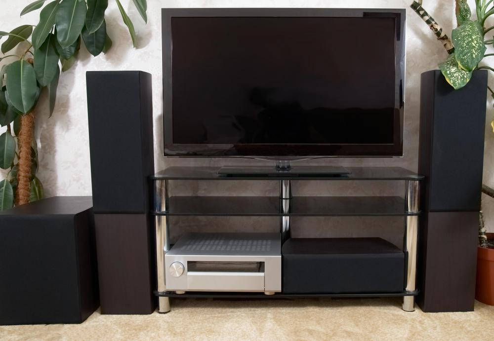 Home theater supplies can include TVs and audio components, often grouped together in an entertainment center or stand.