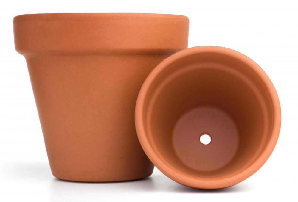 Terra cotta pots may be painted to add color to a garden area.