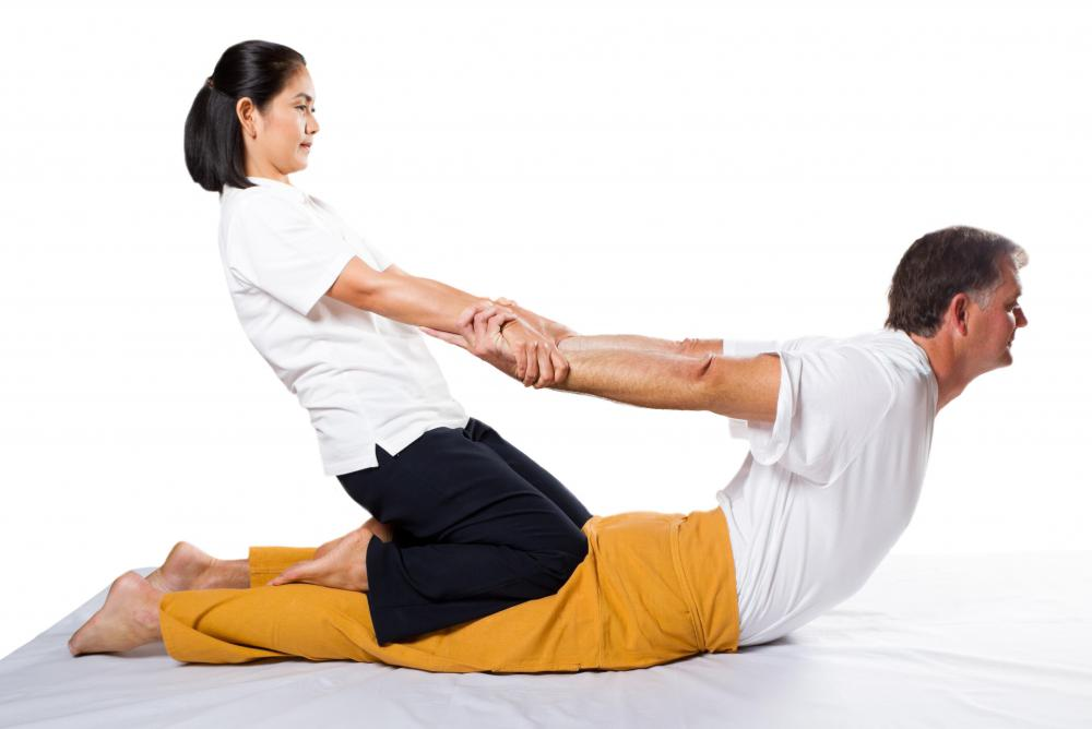 In a Thai massage, a practitioner puts the client's body into various deeply relaxing poses.