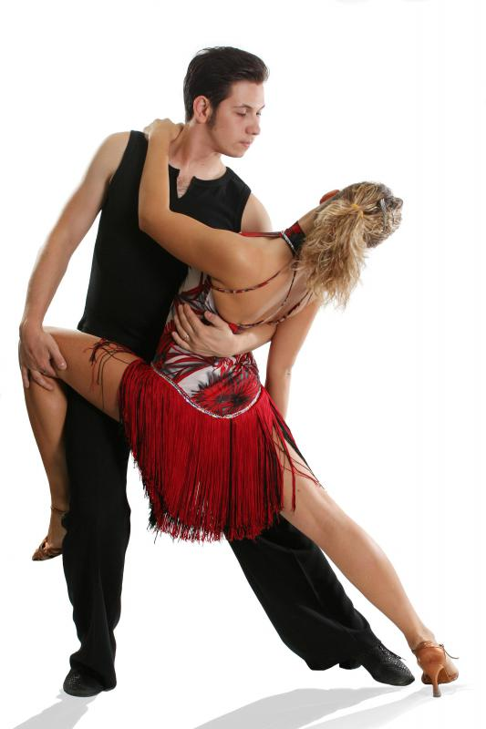 A choreographer may work with a couple on a dance routine.