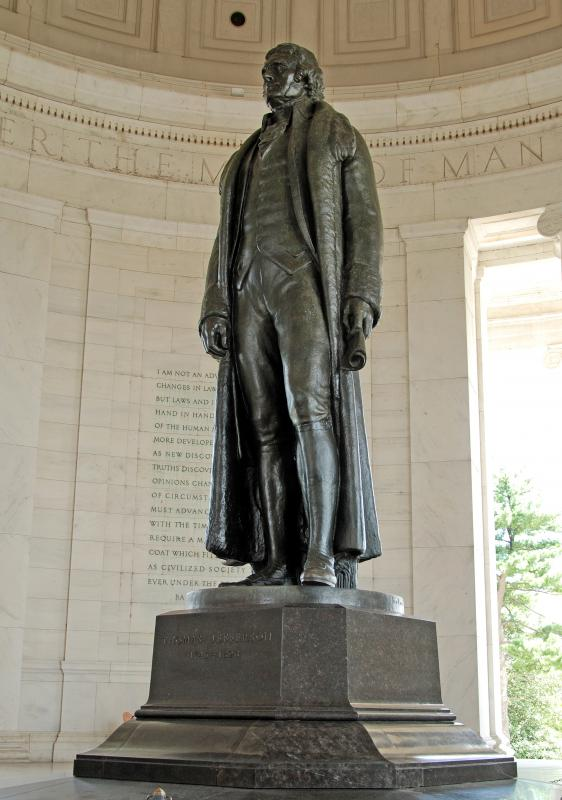 A statue of Thomas Jefferson inside the Jefferson Memorial. The statue is made of bronze, but the memorial building is made of marble.