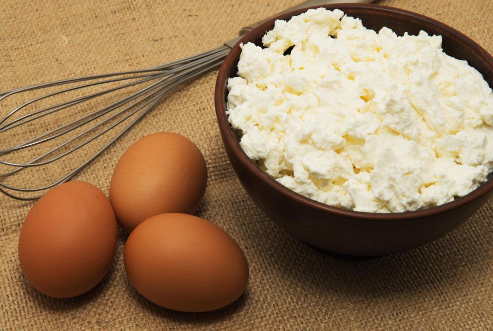 Eggs blended with cottage cheese stiffen the filling of a cheese casserole.