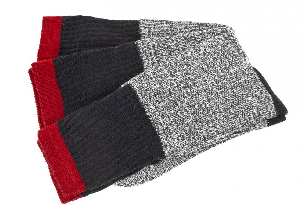 Thick socks can be weather appropriate when monoskiing in cold climates.