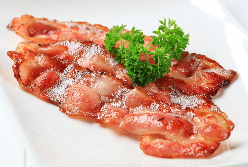 Two strips of fried bacon.
