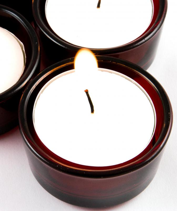 Small, votive candles might be placed to float in water.
