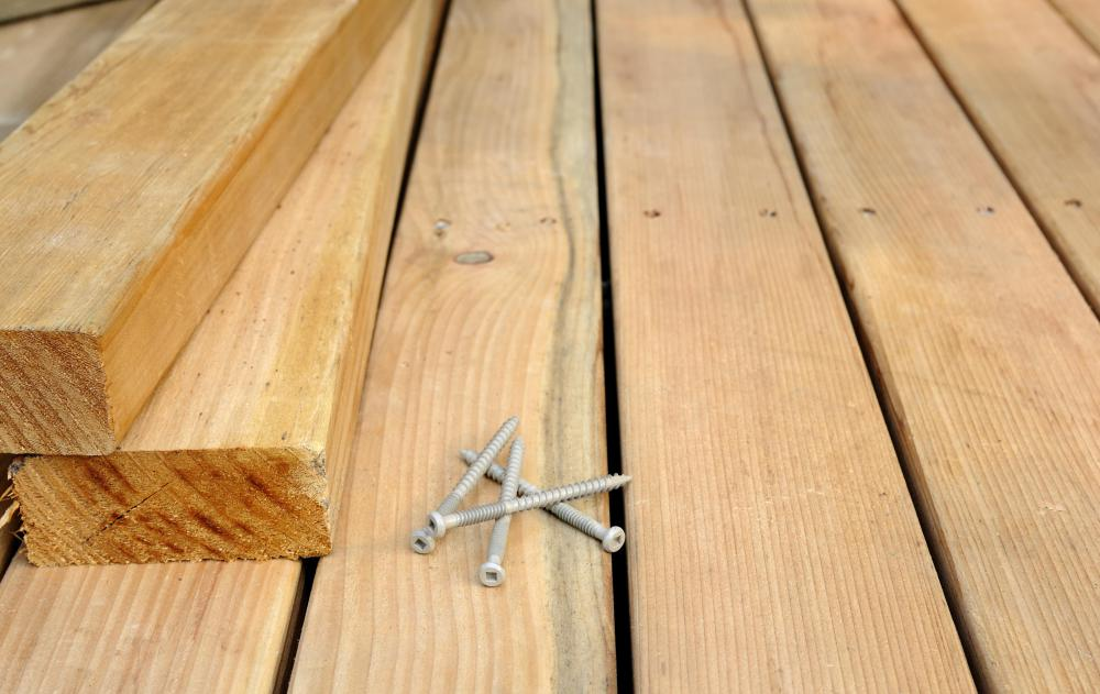 Lag screws, which have coarse threading and a hexagonal head, can be used to secure wooden planks, such as those used for building decks and patios.