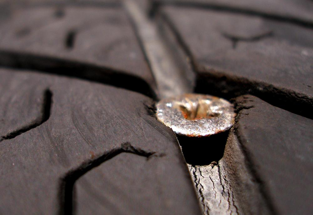 When a tire is punctured by road debris, like a stray nail, the air that escapes will lead to a flat tire.