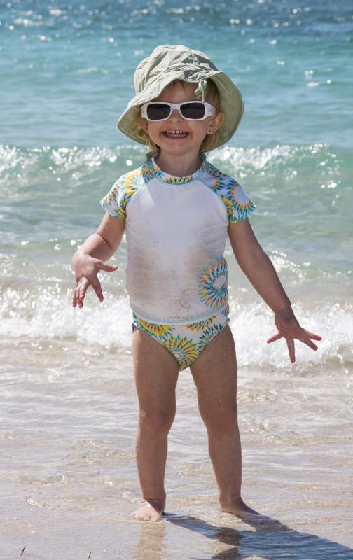 UV rays are very damaging, so children should wear protective clothing when they are in the sun.
