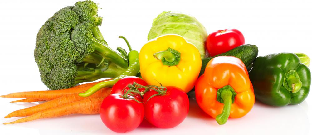 A selection of raw vegetables, including broccoli, carrots, tomatoes, bell peppers, and others.