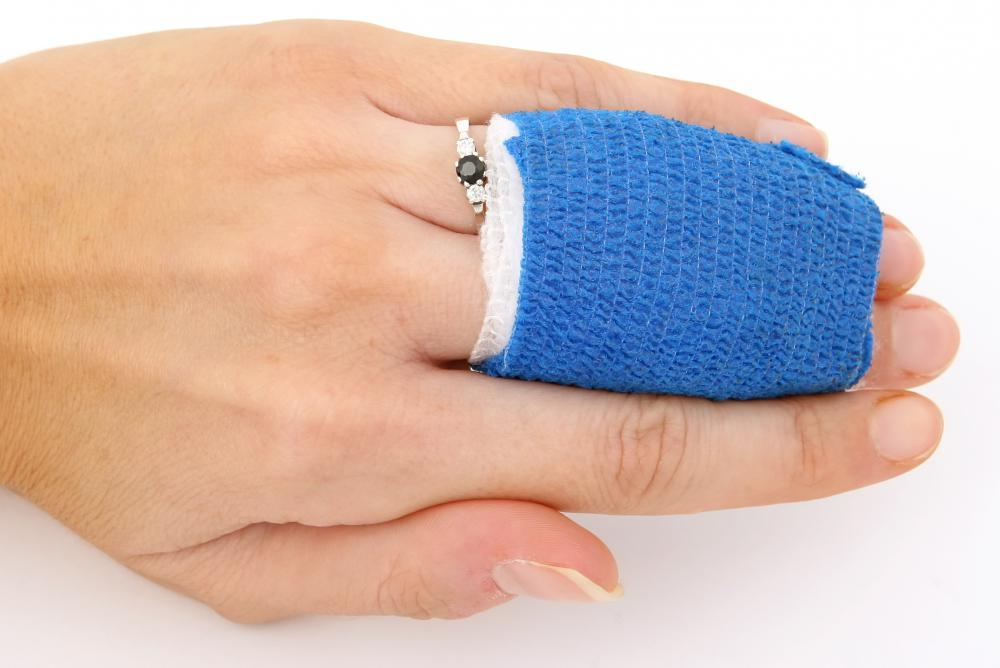 A woman with her jammed finger wrapped.