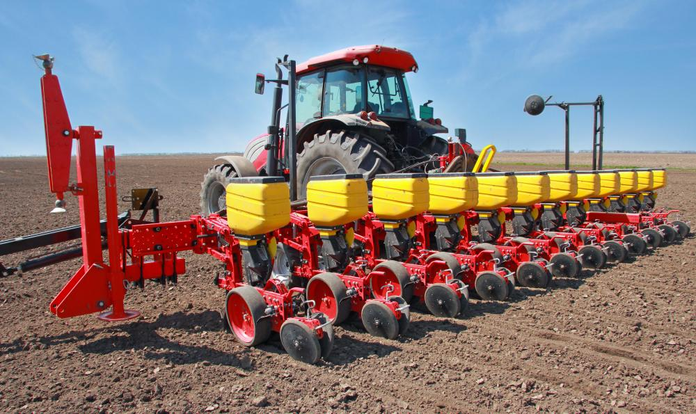 North American farmers typically plant corn in spring with a multi-row planter.