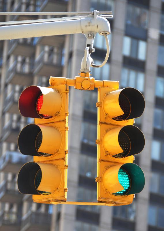Failure to stop at a red light can result in a fine for a traffic violation.