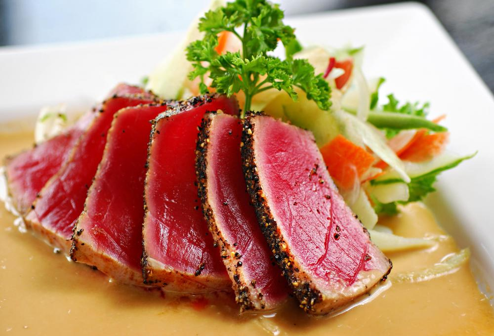 When grilling tuna, impart an Asian flavor using ginger, soy sauce, or sesame oil.