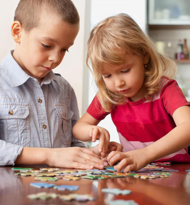 Older children can build fine motor skills by solving jigsaw puzzles.